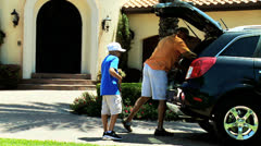 African American Father Son Taking Golf Clubs Car Stock Footage