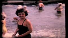 154 - girls smiling & swiming in shallow water at camp - vintage film home movie Stock Footage