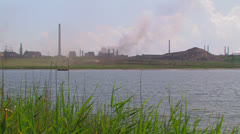 Lake on the background of a large steel plant. Stock Footage
