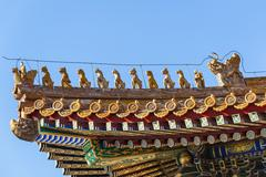 immortal and beasts on the eaves of taihe hall, forbidden city, beijing - stock photo
