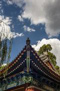 traditional eaves at the chinese building against sunshine - stock photo