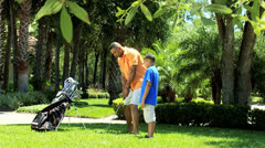 African American Father Son Golf Clubs - stock footage