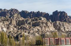 Buildings at the bottom of mountain, zhangye, gansu of china Stock Photos