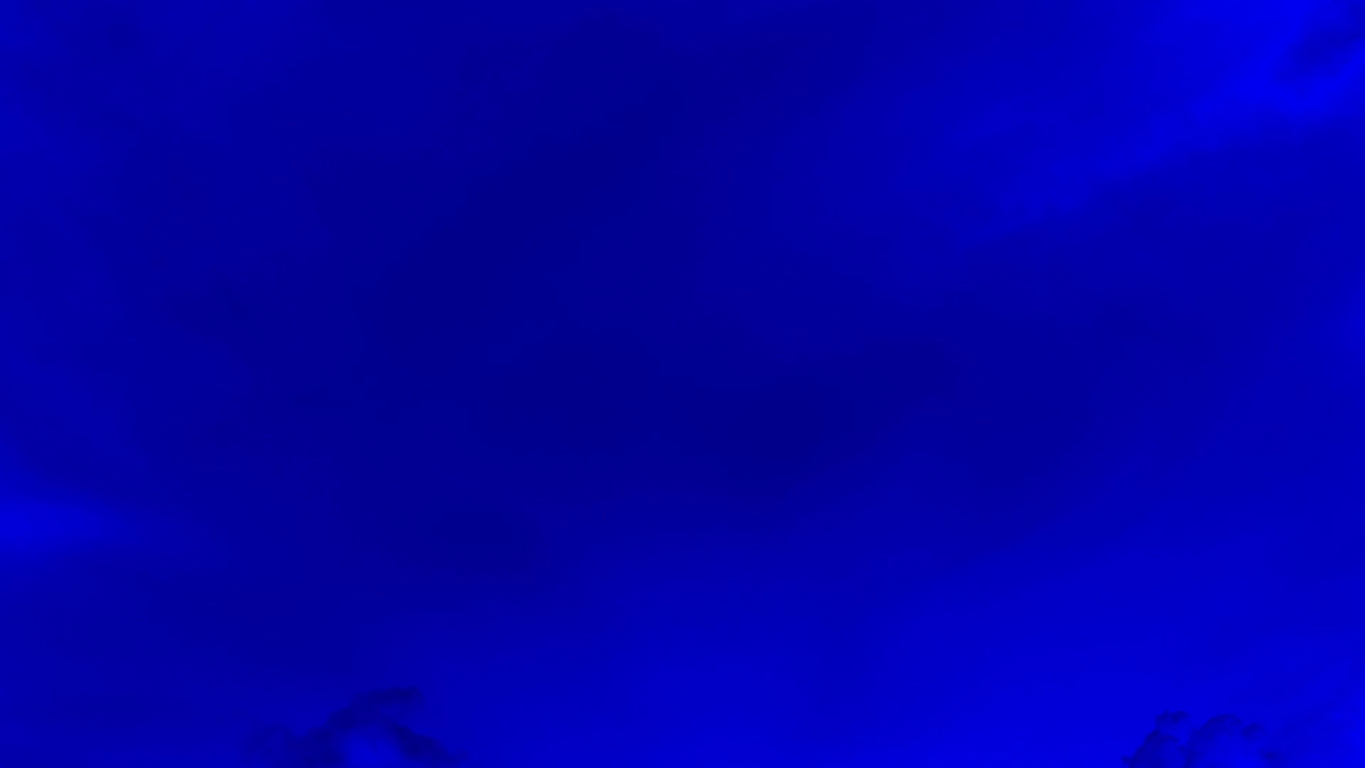 Subtle Clouds Abstract Background In Dark Blue Color