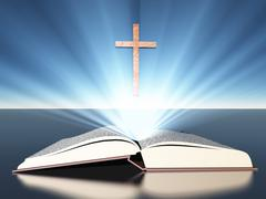 Light radiates from bible under cross Stock Illustration