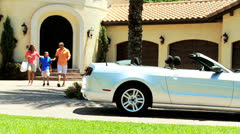 African American Couple Young Son Luxury Convertible - stock footage