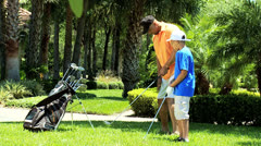 Ethnic Father Son Park Golf Practice - stock footage