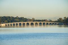 seventeen-arch bridge at summer palace, beijing - stock photo