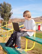 Teen Boy Working on Laptop Stock Photos