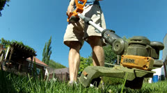 Man Using Weed Trimmer 1 Stock Footage