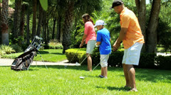 African American Family Practicing Golf Clubs Together Stock Footage