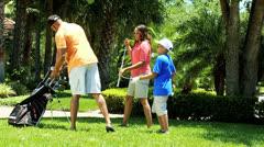 Ethnic Parents Son Park Golf Practice Stock Footage