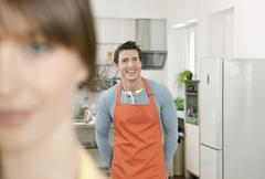 Man and woman standing in domestic kitchen - stock photo