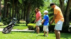 Ethnic Family Healthy Outdoor Lifestyle Golf Practice - stock footage