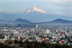 view of mexico city and volcano mountain - stock photo