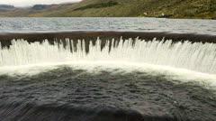Round dam on Pisayambo lagoon, LLanganates national park, Ecuador Stock Footage
