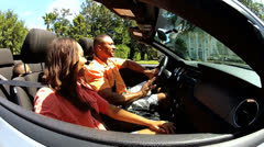 Ethnic Married Couple Driving Home Luxury Convertible Car Stock Footage