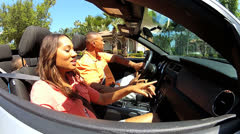 African American Couple Driving Open Top Car - stock footage