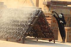 sandblasting  inject chain  in dry dock - stock photo