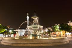 Europe, Portugal, Lisbon, Baixa, View of Bronze fountain and statue of King Stock Photos