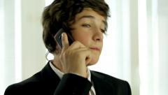 Close up shot of Young Guy in Suit At Home Telephoning Stock Footage