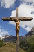 Switzerland, Valais, Leukerbad, View of jesus cross with mountain in background Stock Photos