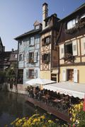 France, Alsace, Colmar, Haut-Rhin, Petite Venise, Pavement cafe with timber Stock Photos