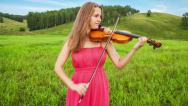 Stock Video Footage of Violinist plays on a green meadow