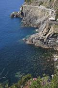 Italy, Liguria, Riomaggiore, Cinque Terre, View of Via Dell'Amore along Stock Photos
