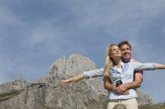 Austria, Salzburg Country, Filzmoos, Man and woman in front of Bischofsmuetze - stock photo