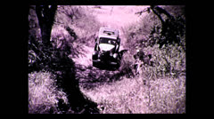 Truck crossing gully on newly built trail,Tanzania 1937 Stock Footage
