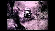 Stock Video Footage of Truck crossing gully on newly built trail,Tanzania 1937