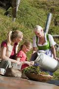 Austria, Salzburg Country, Filzmoos, Young women and girl sitting while senior Stock Photos
