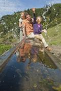 Austria, Salzburg Country, Filzmoos, Family on alpine Stock Photos