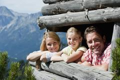 Austria, Salzburg Country, Filzmoos, Family on a hide at alpine - stock photo