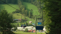 Mother child chair lift Stock Footage