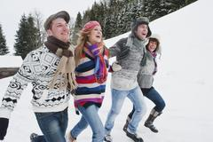 Austria, Salzburg Country, Flachau, Young people having fun in snow - stock photo