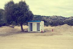 Greece, Rhodes, View of public toilet on beach Stock Photos