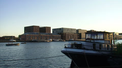 Restored and new built warehouses at the bank of the IJ waterfront Amsterdam Stock Footage
