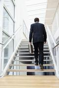 Stock Photo of Germany, Bavaria, Diessen am Ammersee, Businesssman walking on staircase with