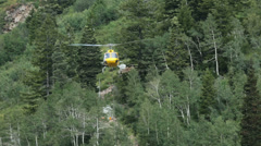 Helicopter lifts lumber on high mountain HD 8645 Stock Footage