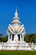Spire of the white temple Stock Photos