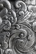 engraving on silver, background - stock photo