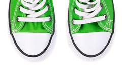 front of the green sneakers - stock photo