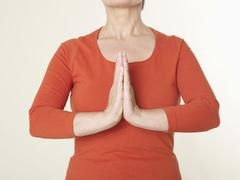 Stock Photo of Senior woman in praying position