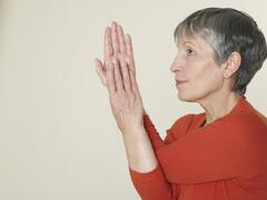 Senior woman twisting her hands Stock Photos