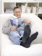 Stock Photo of Germany, Hamburg, Senior man reading book