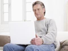 Stock Photo of Germany, Hamburg, Senior man using laptop