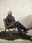 Stock Photo of Germany, Hamburg, Senior woman relaxing on chair