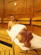 Germany, Hamburg, Mature man in sauna, smiling, portrait Stock Photos